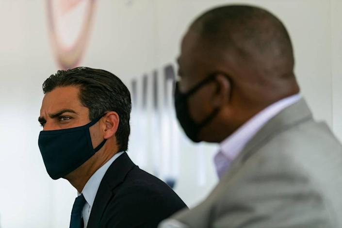 Miami Mayor Francis Suarez attends a press conference in Miami's Overtown neighborhood on Tuesday, March 2, 2021. Officials celebrated the opening of a new state operated walk-up COVID-19 vaccination site.