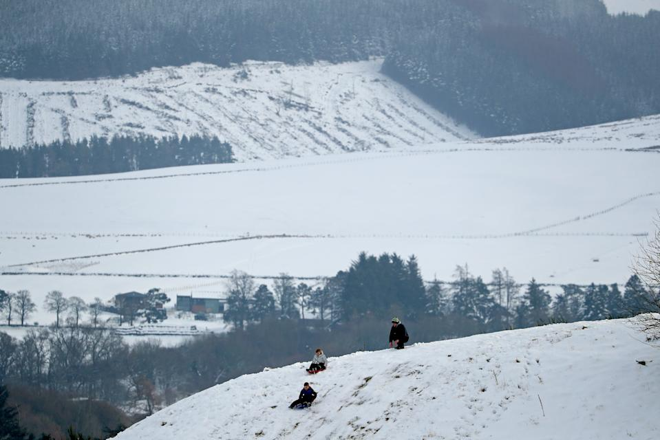 People sledging on the snow covered golf course at Gleneagles in Auchterarder, Perthshire. Heavy snow and freezing rain is set to batter the UK this week, with warnings issued over potential power cuts and travel delays. (Photo by Andrew Milligan/PA Images via Getty Images)