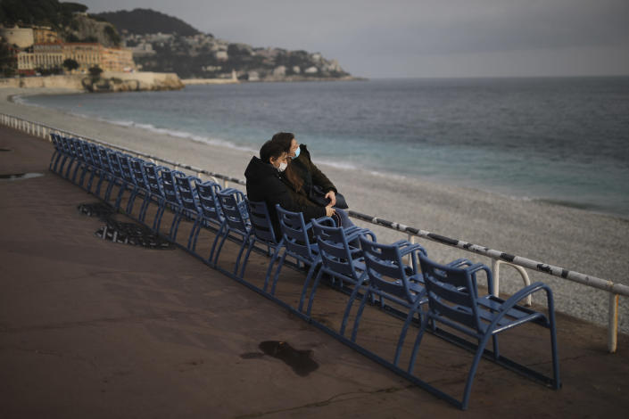 FILE - In this Saturday, Feb. 27, 2021 filer, people enjoy the view at the Promenade des Anglais in Nice, southern France. Europe recorded 1 million new COVID-19 cases last week, an increase of 9% from the previous week and ending a six-week decline, WHO said Thursday, March 4, 2021. The so-called UK variant is of greatest concern in the 53 countries monitored by WHO in Europe. (AP Photo/Daniel Cole, File)