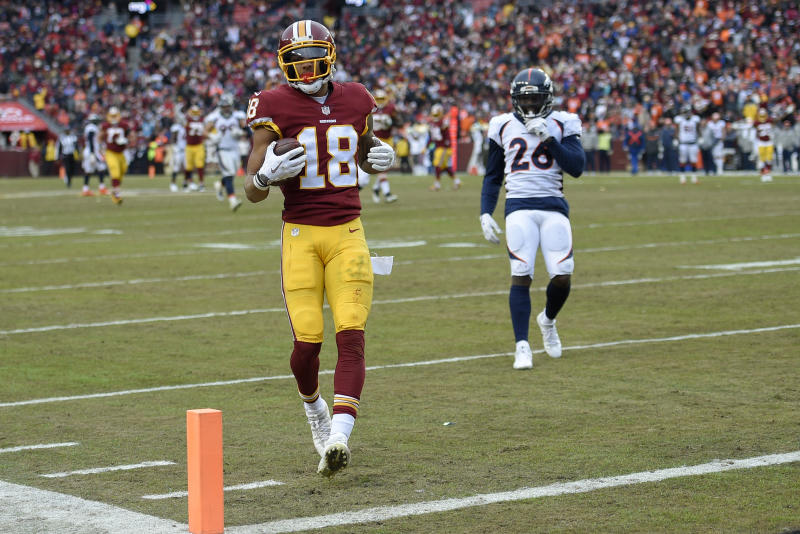 Washington Redskins wide receiver Josh Doctson (18) carries the ball into the end zone for a touchdown during the second half an NFL football game against the Denver Broncos in Landover, Md., Sunday, Dec 24, 2017. (AP Photo/Nick Wass)