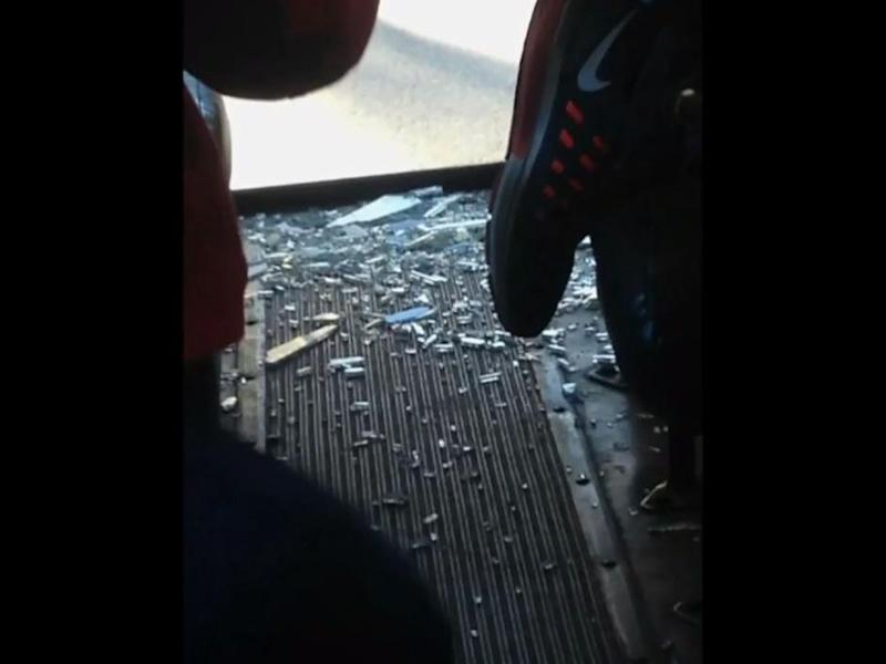 The back window of the bus was smashed by the crash into a tree: 7 News Boston