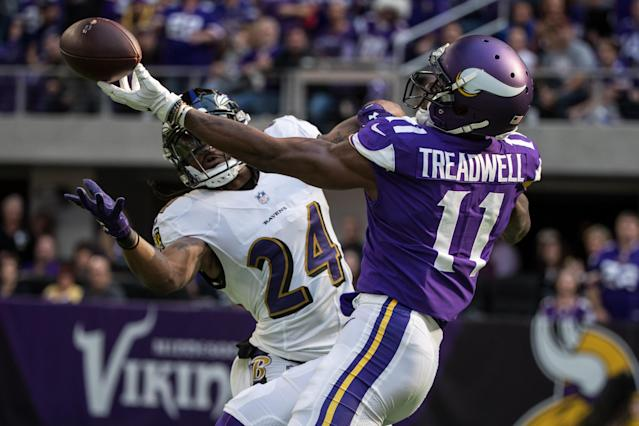 <p>Baltimore Ravens cornerback Brandon Carr (24) intercepts a pass intended for Minnesota Vikings wide receiver Laquon Treadwell (11) during the first quarter at U.S. Bank Stadium. Mandatory Credit: Brace Hemmelgarn-USA TODAY Sports </p>