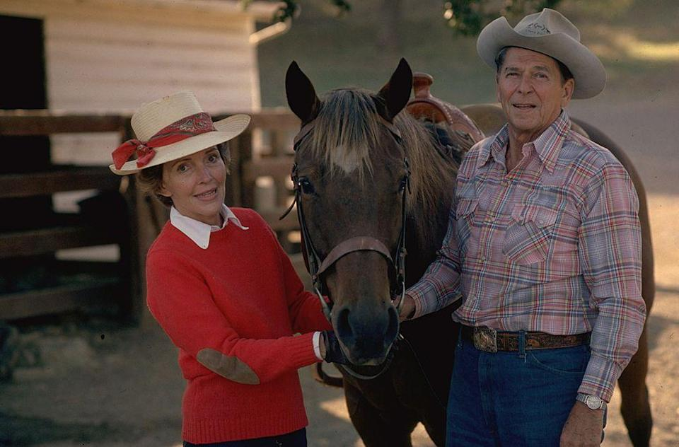 <p>While campaigning for the Republican presidential nomination, then-Governor Ronald Reagan was photographed with Nancy at their Santa Barbara, California ranch, holding the reigns of a horse. </p>