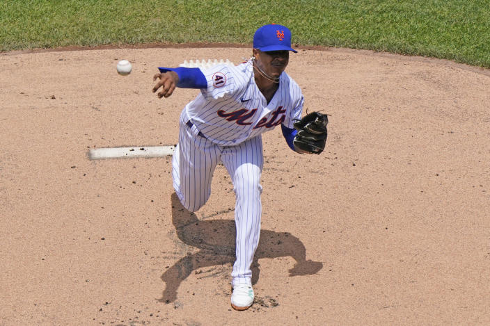 New York Mets starting pitcher Marcus Stroman (0) delivers during the first inning of a baseball game against the Philadelphia Phillies, Sunday, June 27, 2021, in New York. (AP Photo/Kathy Willens)