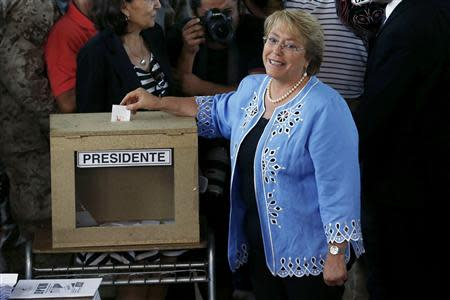 Chilean presidential candidate Michelle Bachelet casts her ballot during the presidential election in Santiago