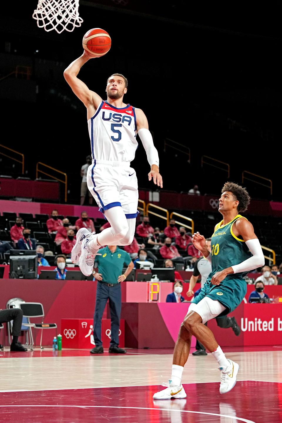 Zach Lavine dunks the ball as Matisse Thybulle pursues during the United States' win over Australia.