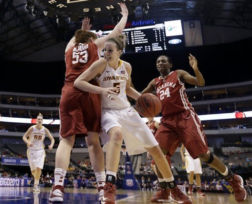 Iowa State's Hallie Christofferson (5) fights for a shot-opportunity as Oklahoma's Joanna McFarland (53) and Sharane Campbell (24) defend in the second half of an NCAA college basketball game in the Big 12 women's tournament on Sunday, March 10, 2013, in Dallas. Iowa State won 79-60. (AP Photo/Tony Gutierrez)