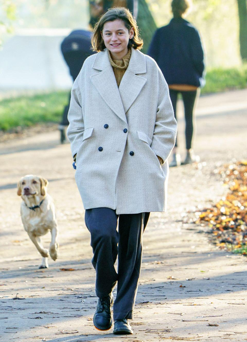 <p>Emma Corrin, who plays Princess Diana on Netflix's <em>The Crown</em>, takes her dog out for a morning walk on Sunday in North London.</p>