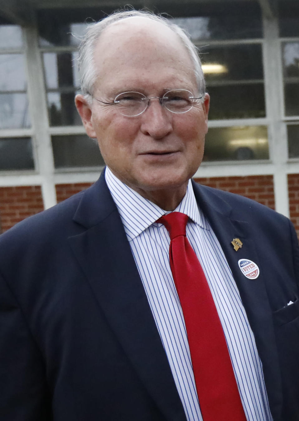 Former Mississippi Supreme Court Chief Justice Bill Waller Jr., speaks to reporters about his hopes for a big turnout of supporters in his runoff race against Lt. Governor Tate Reeves for the GOP nomination for governor, Tuesday, Aug. 27, 2019 at his Jackson, Miss., voting precinct. (AP Photo/Rogelio V. Solis)