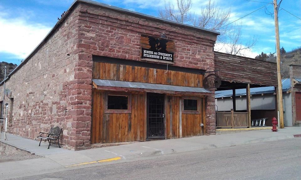 """<p>This <a href=""""https://www.tripadvisor.com/Restaurant_Review-g60482-d6751127-Reviews-Miners_and_Stockmen_s_Steakhouse_Spirits-Hartville_Wyoming.html"""" rel=""""nofollow noopener"""" target=""""_blank"""" data-ylk=""""slk:rustic steakhouse"""" class=""""link rapid-noclick-resp"""">rustic steakhouse</a> in Hartville is housed in one of the only remaining structures from Old Fort Laramie, and the Old West atmosphere lives on. The impressive whiskey selection is great company while drinking in the 1862 lore about outlaws, bank robbers, and cattle rustlers who supposedly used this spot as a hideout.</p>"""
