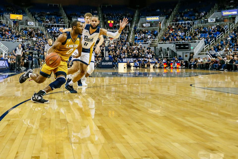 RENO, NEVADA - NOVEMBER 19: Milan Acquaah #0 of the California Baptist Lancers drives to the basket durign the second half against the Nevada Wolf Pack at Lawlor Events Center on November 19, 2018 in Reno, Nevada.