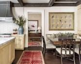 <p>In the breakfast book, a grid of pressed botanicals framed all together echoes the geometric patterns in the ceiling beams and the dining chair backs.</p>