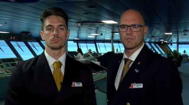 Carnival Glory Captain Pero Grubjesic and Safety Officer Cesare Mattera discuss the rescue of a crew member from a Norwegian cruise ship on Sunday, July 1, 2018. (Carnival Cruise Lines)