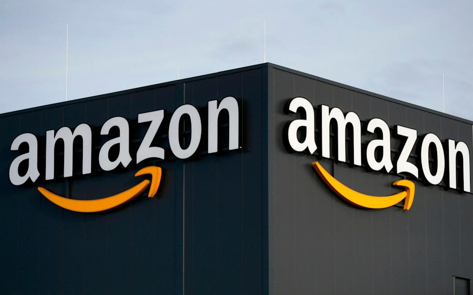 the logo of US online retail giant Amazon - INA FASSBENDER / AFP