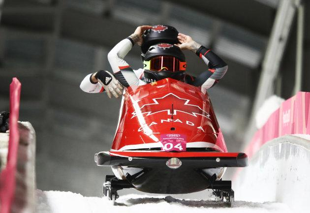 Kaillie Humphries and Phylicia George of Canada celebrate in the finish area during the women's bobsled event.