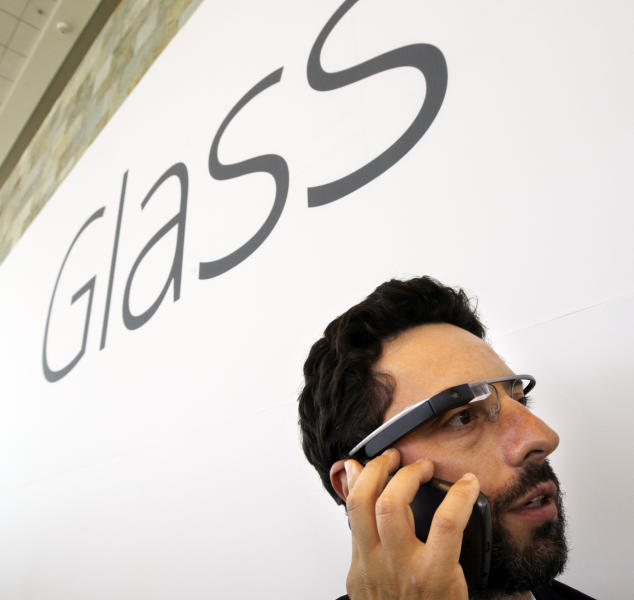 Google co-founder Sergey Brin talks on the phone as he wears Google's new Internet-connected glasses at the Google I/O conference in San Francisco, Wednesday, June 27, 2012. Google is making prototypes of the device, known as Project Glass, available to test. They can only be purchased — for $1,500 — at the conference this week, for delivery early next year. (AP Photo/Paul Sakuma)