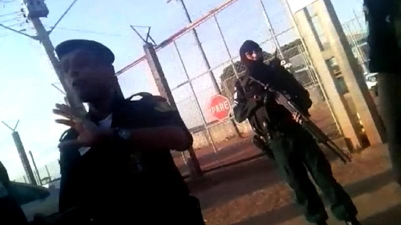 Video grab taken from Folha de Boa Vista shows police officers standing guard as relatives of inmates gather outside the Agricola de Monte Cristo prison in Boa Vista, in the Brazilian northern state of Roraima, on October 16, 2016