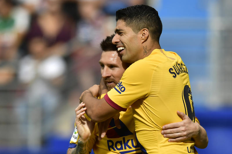 Barcelona's Luis Suarez, celebrates after scoring his side's third goal with Lionel Messi during a Spanish La Liga soccer match between Eibar and FC Barcelona at the Ipurua stadium in Eibar, Spain, Saturday Oct. 19, 2019. (AP Photo/Alvaro Barrientos)