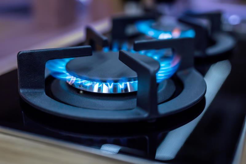 Natural gas flames on a stove cooktop.