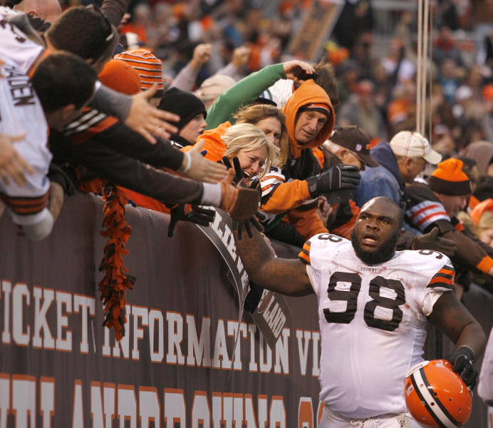 CLEVELAND, OH - NOVEMBER 20:  Defensive lineman Phil Taylor #98 of the Cleveland Browns celebrates with fans after their 14-10 victory over the Jacksonville Jaguars at Cleveland Browns Stadium on November 20, 2011 in Cleveland, Ohio.  (Photo by Matt Sullivan/Getty Images)