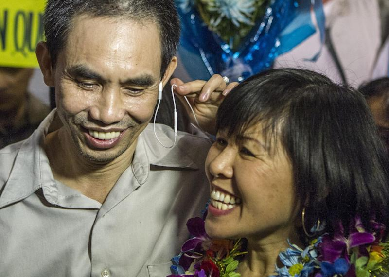 Human rights activist Nguyen Quoc Quan with his wife Huong Mai Ngo smile during a news conference after his arrival at the Los Angeles International Airport from Vietnam on Wednesday, Jan. 30, 2013, in Los Angeles.  Quan has been released after being detained since April 17, 2012 in Ho Chi Minh City, Vietnam. (AP Photo/Ringo H.W. Chiu)