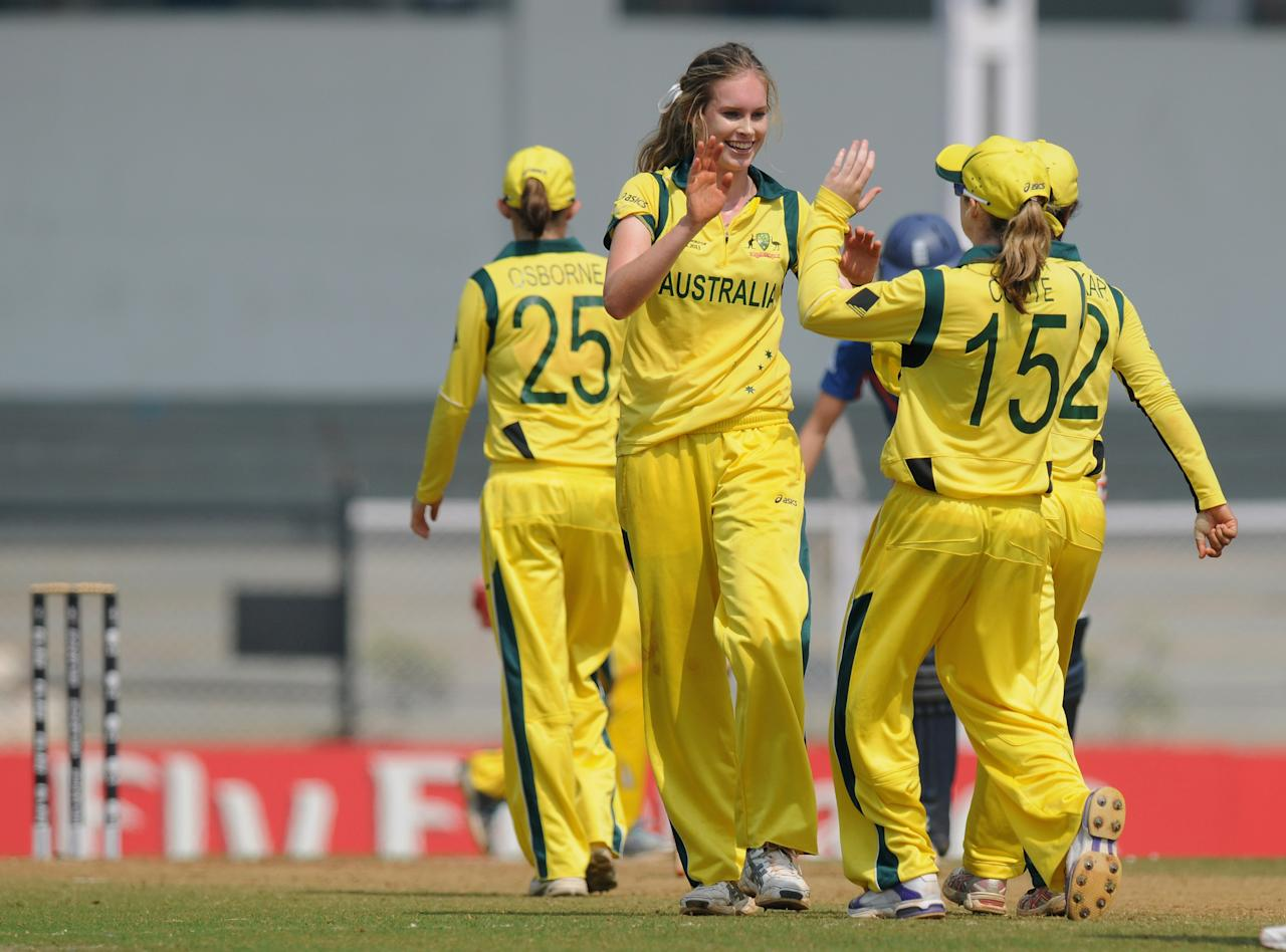 MUMBAI, INDIA - FEBRUARY 08:  Holly Ferling of Australia celebrates a wicket during the super six match  between England and Australia held at the CCI (Cricket Club of India)  on February 8, 2013 in Mumbai, India.  (Photo by Pal Pillai/Getty Images)