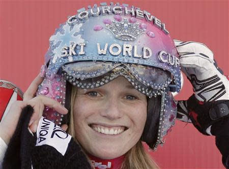 Marlies Schild of Austria celebrates on the podium after winning the Women's World Cup Slalom skiing race in Courchevel, French Alps, December 17, 2013. REUTERS/Christian Hartmann