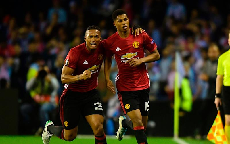 Manchester United's forward Marcus Rashford (R) celebrates with his teammate Ecuadorian defender Antonio Valencia - Credit: GETTY IMAGES