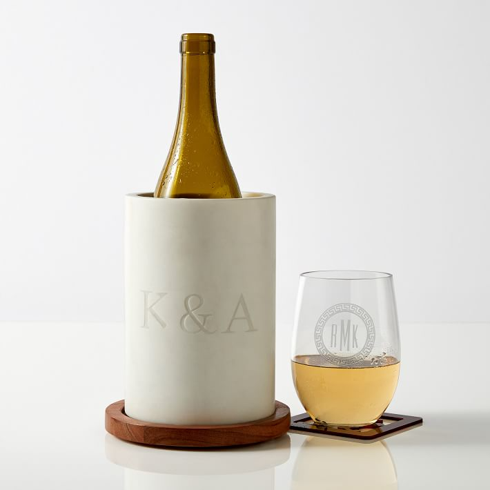 """<h3>Mark & Graham Wood And Marble Wine Chiller</h3><br>For the host with the most, consider this chic wood and marble chiller featuring the initials of your choosing. <br><br><em>Shop <strong><a href=""""https://www.markandgraham.com/"""" rel=""""nofollow noopener"""" target=""""_blank"""" data-ylk=""""slk:Mark & Graham"""" class=""""link rapid-noclick-resp"""">Mark & Graham</a></strong></em><br><br><strong>Mark & Graham</strong> Wood And Marble Wine Chiller, $, available at <a href=""""https://go.skimresources.com/?id=30283X879131&url=https%3A%2F%2Fwww.markandgraham.com%2Fproducts%2Fwood-and-marble-wine-chiller%2F"""" rel=""""nofollow noopener"""" target=""""_blank"""" data-ylk=""""slk:Mark & Graham"""" class=""""link rapid-noclick-resp"""">Mark & Graham</a>"""