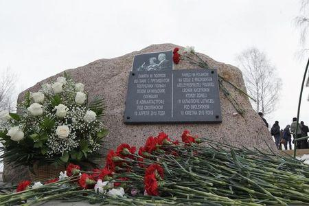 Flowers are placed by a memorial stone during a remembrance ceremony at the site of the 2010 plane crash that killed former Polish President Kaczynski and 95 others near the Russian city of Smolensk