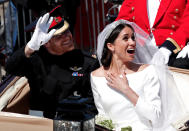 <p>The couple were greeted by rapturous applause as their carriage took them through Windsor. (Reuters) </p>