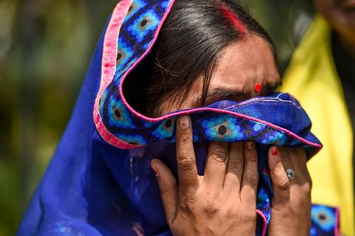 Punita Devi, wife of Akshay Thakur, one of the four men convicted for the gang-rape and murder case of a student, spoke to media representatives, outside the Patiala House Court in New Delhi on March 19, 2020 (AFP Photo/Prakash SINGH )