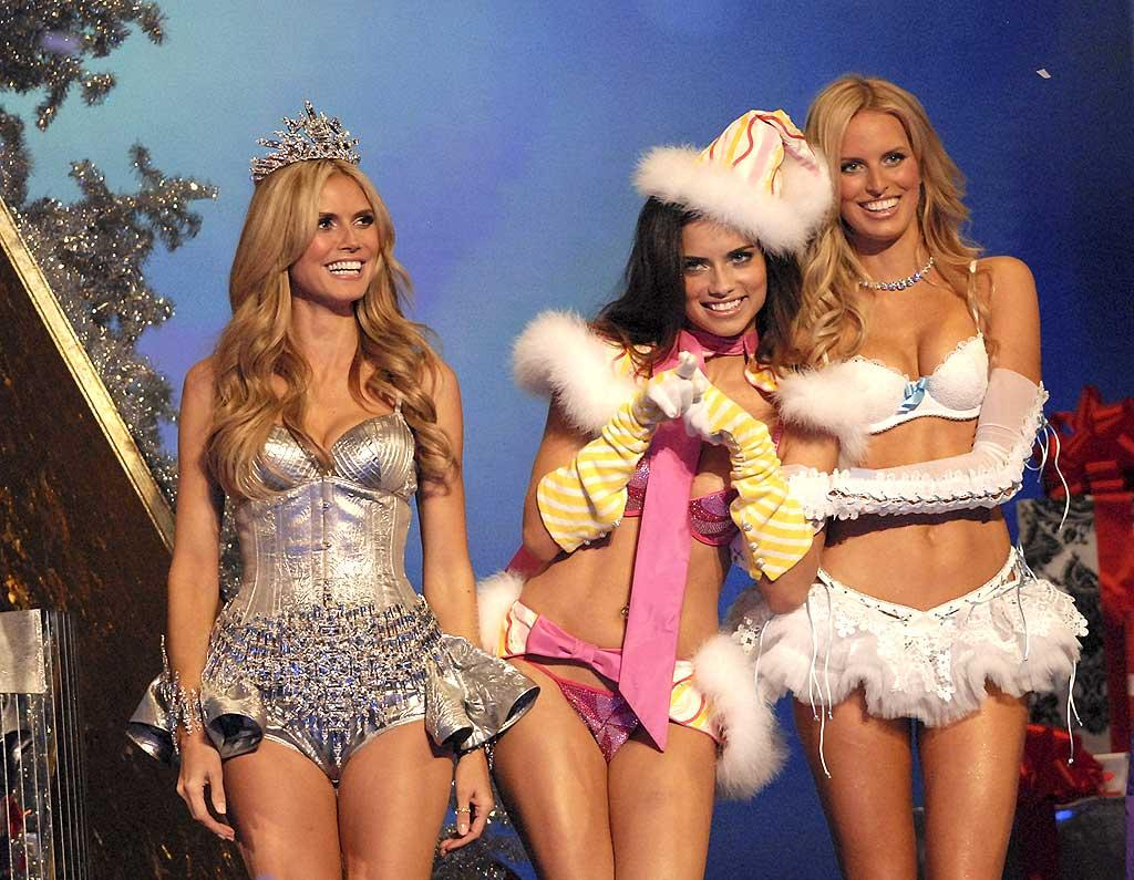 "Who's naughty and who's nice? Heidi Klum, Adriana Lima, and Karolina Kurkova hit the runway at the 12th Annual Victoria's Secret Fashion Show at the Kodak Theater in Los Angeles. Kevin Mazur/<a href=""http://www.wireimage.com"" target=""new"">WireImage.com</a> - November 15, 2007"