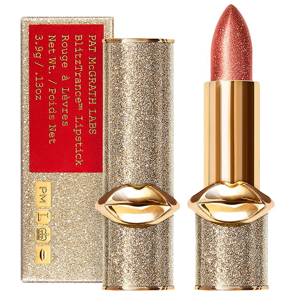 """<p>This iridescent <a rel=""""nofollow"""" href=""""https://www.popsugar.com/buy/PAT%20McGRATH%20LABS%20BlitzTrance%20Lipstick-404523?p_name=PAT%20McGRATH%20LABS%20BlitzTrance%20Lipstick&retailer=sephora.com&price=38&evar1=fab%3Aus&evar9=45664445&evar98=https%3A%2F%2Fwww.popsugar.com%2Ffashion%2Fphoto-gallery%2F45664445%2Fimage%2F45664561%2FPAT-McGRATH-LABS-BlitzTrance-Lipstick&list1=shopping%2Cmakeup%2Cbeauty%20products%2Clipstick%2Cliquid%20lipstick%2Cpat%20mcgrath%2Cbeauty%20shopping%2Cbest%20of%202019&prop13=mobile&pdata=1"""" rel=""""nofollow"""">PAT McGRATH LABS BlitzTrance Lipstick </a> ($38) will give you a shimmery dose of color that's creamy and shiny.</p>"""