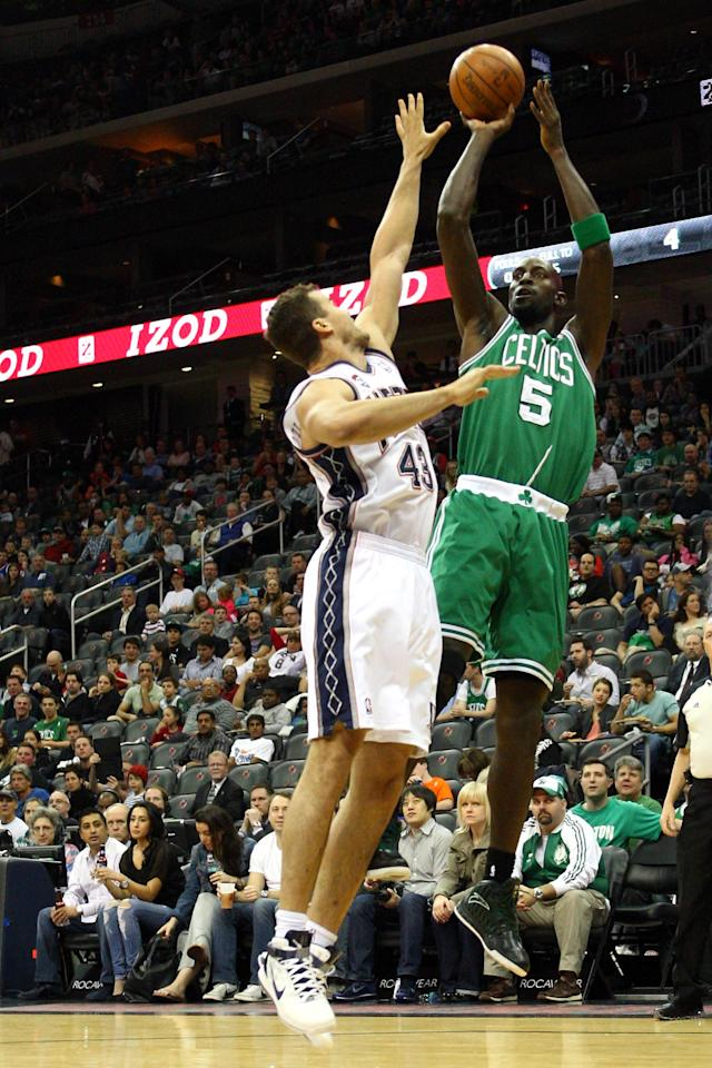 NEWARK, NJ - APRIL 14: Kevin Garnett #5 of the Boston Celtics attempts a shot in the first half against Kris Humphries #43 of the New Jersey Nets at Prudential Center on April 14, 2012 in Newark, New Jersey. NOTE TO USER: User expressly acknowledges and agrees that, by downloading and or using this photograph, User is consenting to the terms and conditions of the Getty Images License Agreement. (Photo by Chris Chambers/Getty Images)