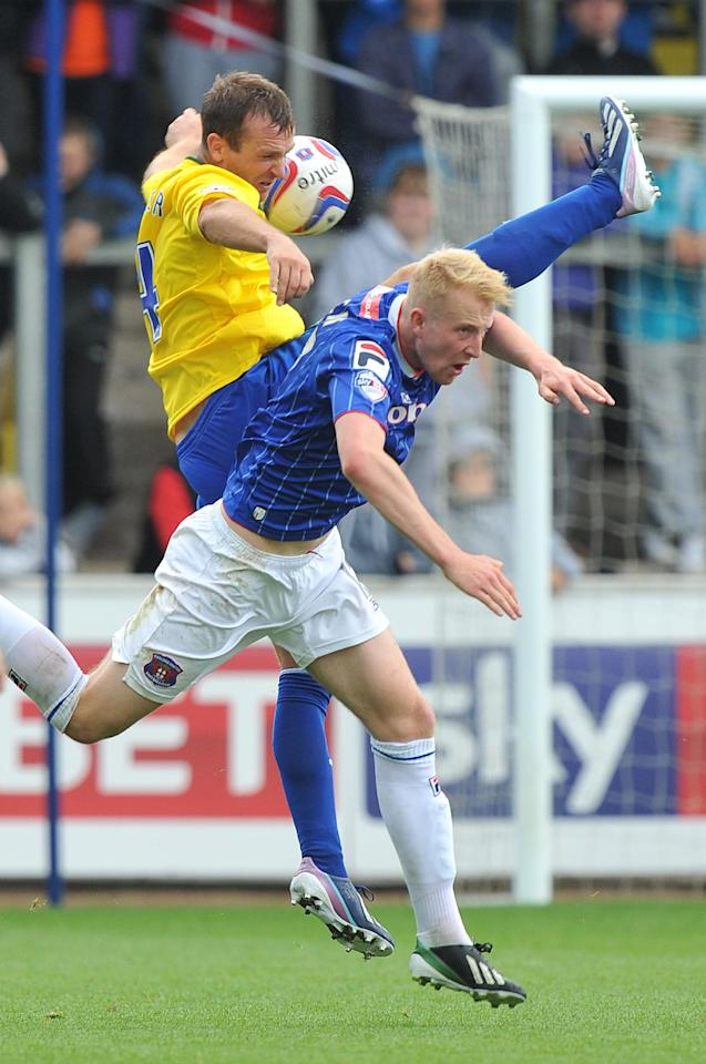 Coventry City's Andy Webster out jumps Carlisle United's Mark Beck during the Sky Bet Football League One match at Brunton Park, Carlisle.