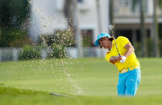 PALM BEACH GARDENS, FL - MARCH 01: Rickie Fowler hits out of the fairway bunker the 18th hole during the first round of the Honda Classic at PGA National on March 1, 2012 in Palm Beach Gardens, Florida. (Photo by Mike Ehrmann/Getty Images)