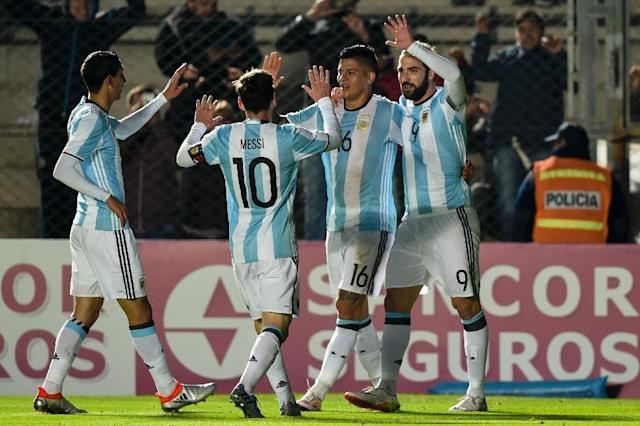Argentina's Gonzalo Higuain (R) celebrates with teammates after scoring against Honduras during a friendly match at Bicentenario stadium in San Juan (AFP Photo/Eitan Abramovich)