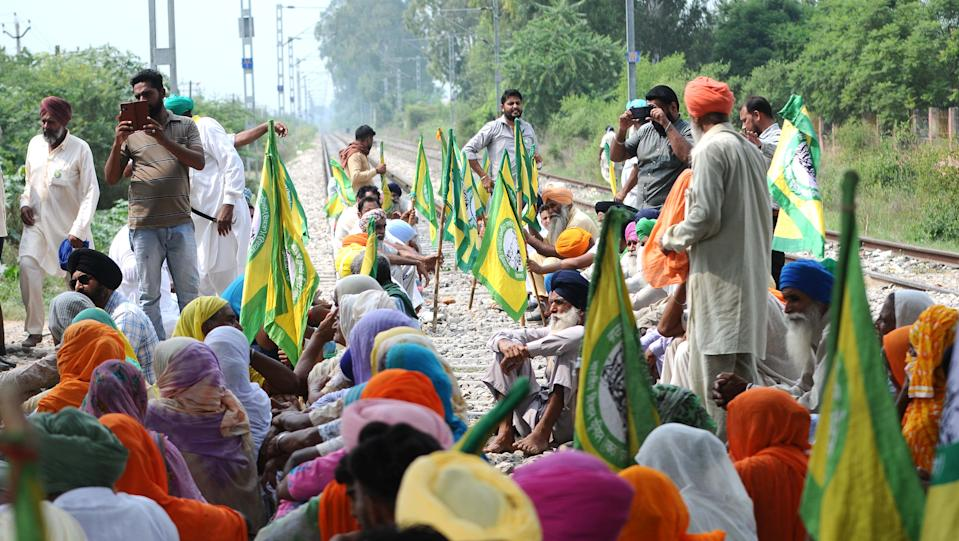 Members of BKU Ugrahan block railway tracks during a protest against the agriculture bills at Nabha, on September 24, 2020 in Patiala, India. (Photo by Bharat Bhushan/Hindustan Times via Getty Images)