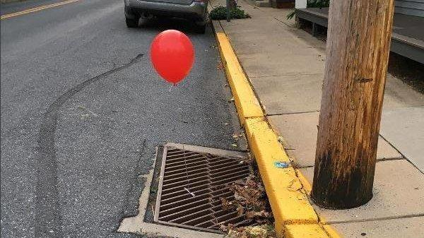 Red Balloons Are Popping Up On Storm Grates Ahead Of 'It' Movie