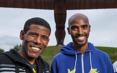 <span>Gebrselassie (left) and Farah, pictured together in 2013</span> <span>Credit: PA </span>