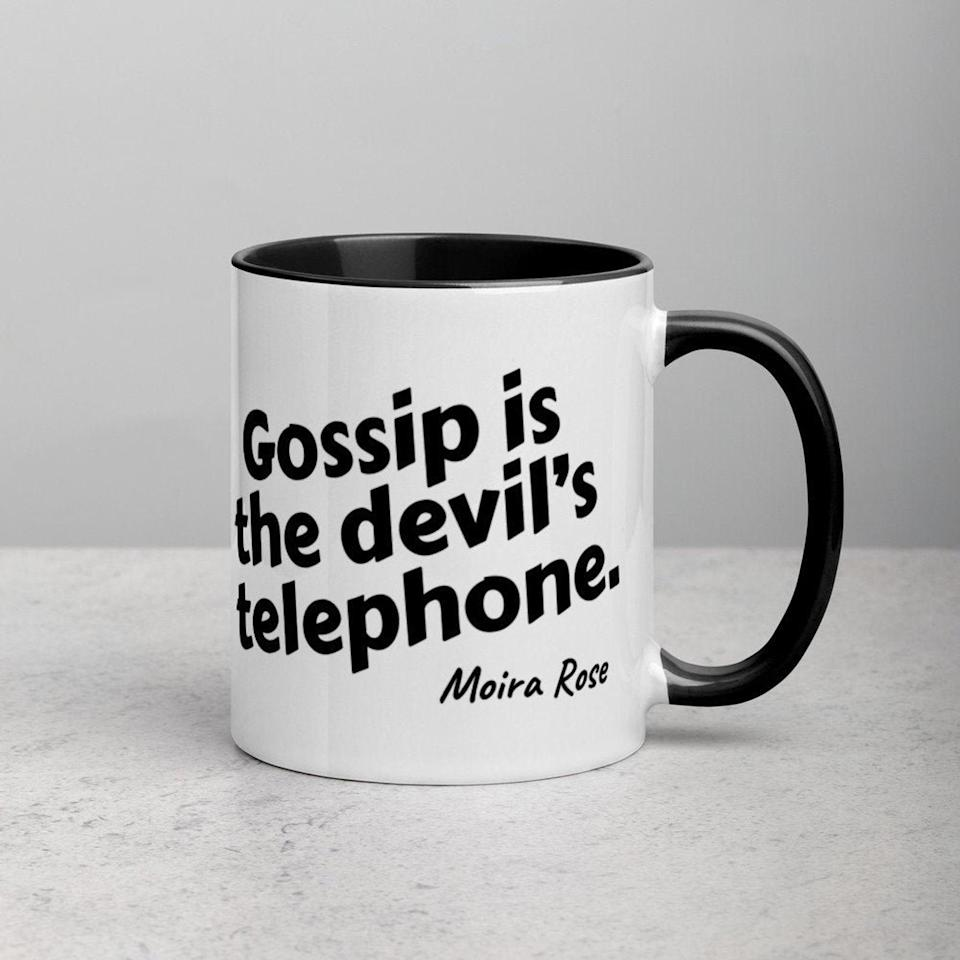 """<p>But how cool would they be if they had a <span>""""Gossip Is the Devil's Telephone"""" Moira Rose Mug</span> ($14) while gossiping?</p>"""