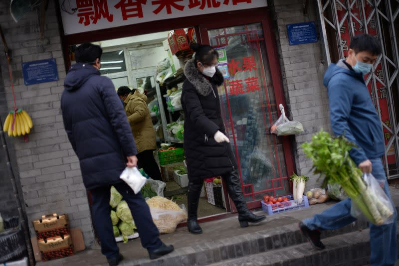 Residents buy food in a greengrocer's shop at a hutong, as the country is hit by an outbreak of the novel coronavirus, in Beijing
