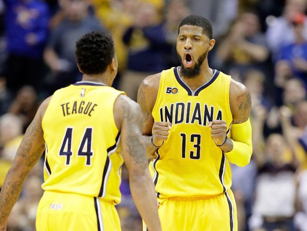 "<a class=""link rapid-noclick-resp"" href=""/nba/players/4725/"" data-ylk=""slk:Paul George"">Paul George</a> and <a class=""link rapid-noclick-resp"" href=""/nba/players/4624/"" data-ylk=""slk:Jeff Teague"">Jeff Teague</a>. (Getty Images)"