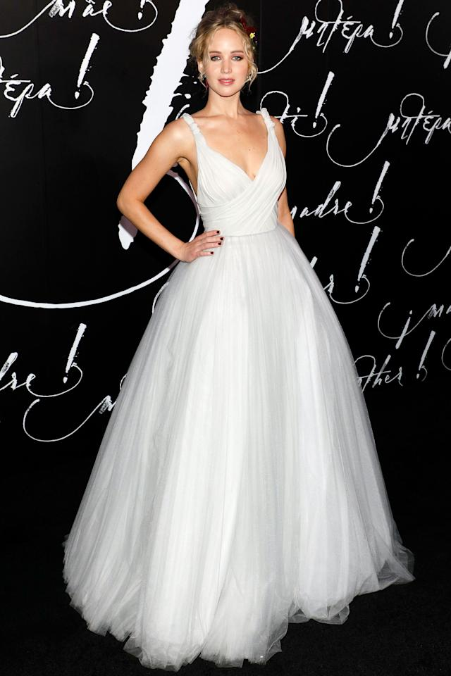 <p>The actress stunned in a white Dior ballgown paired with wedding-style flowers in her hair.<br /><i>[Photo: Getty]</i> </p>