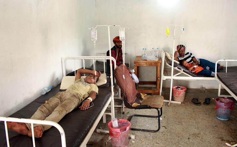 Yemenis displaced from an area near the Saudi border and believed to be suffering from dengue fever, rest in the clinic of a makeshift camp in the country's northern Hajjah province, on October 19, 2019: AFP/Getty