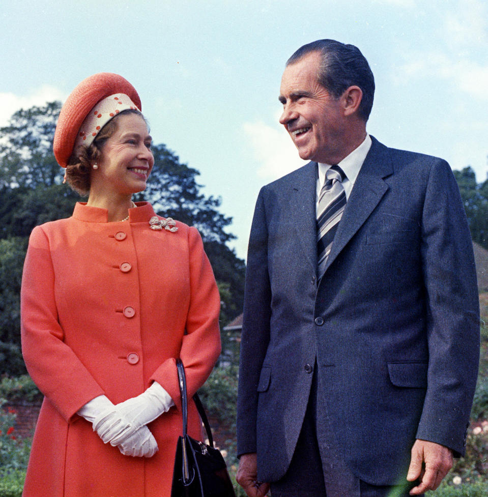 FILE - In this 1970 file photo, Queen Elizabeth II, left, reacts with U.S. President Richard Nixon, at Chequers, in Buckinghamshire, England. (AP Photo, File)