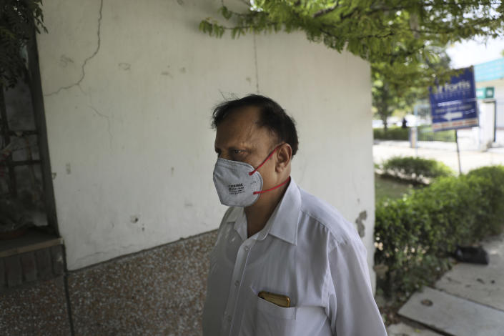 Anil Sharma leaves a hospital after visiting his son, Saurav, who is being treated for COVID-19 at a private hospital in New Delhi, India, Thursday, July 1, 2021. Life is tentatively returning to normal in India as coronavirus cases fall. But millions are embroiled in a nightmare of huge piles of medical bills. Most Indians don't have health insurance and costs for COVID-19 treatment have them drowning in debt. (AP Photo/Manish Swarup)