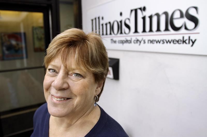 In this photo taken Feb. 24, 2012, Sharon Whalen, Publisher of the Illinois Times, is seen at work in Springfield, Ill. Whalen's small business, a weekly alternative newspaper, got a tax credit to help with cost of providing health care coverage to her employees. As the U.S. Supreme Court prepares to hear arguments on President Barack Obama's health care overhaul, The Associated Press spoke with a variety of people to hear their experiences so far with the landmark legislation, whose major provisions don't take effect until 2014. Reporters asked: How has the health care law affected your life? As a co-owner of the Illinois Times, a weekly newspaper, Whalen wants to keep her small staff healthy. So she and her business partner provide them with health insurance and pay half the cost of premiums for their 10 employees. Keeping that employee benefit is getting more and more expensive. The company saw a spike in premium costs after one employee's child had chronic health problems. (AP Photo/Seth Perlman)
