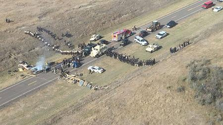 Protesters against the Dakota Access Pipeline stand-off with police in this aerial photo of Highway 1806 and County Road 134 near the town of Cannon Ball, North Dakota. Morton County Sheriff's Office
